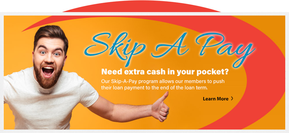Young man smiling.Skip A Pay Need Extra Cash in  your pocket? Learn More